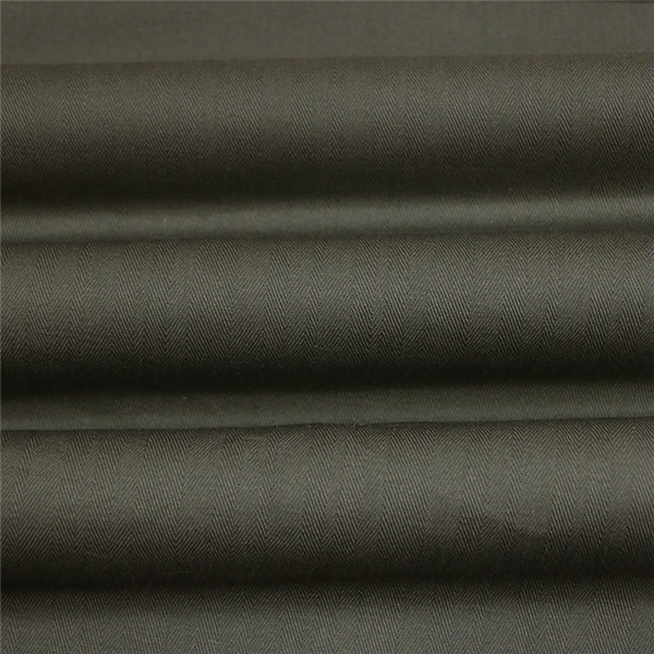 Olive green herringbone uniform fabric for making uniforms Featured Image